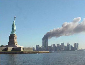 300px-National_Park_Service_9-11_Statue_of_Liberty_and_WTC_fire